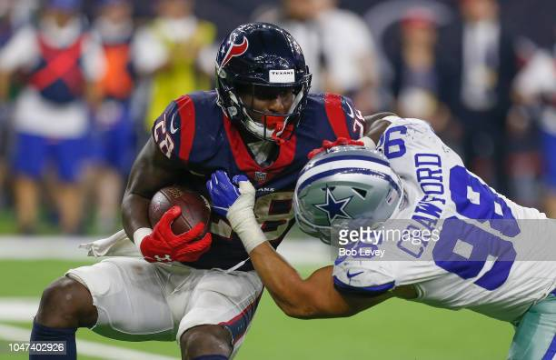 Alfred Blue of the Houston Texans is tackled by Tyrone Crawford of the Dallas Cowboys in hte fourth quarter at NRG Stadium on October 7 2018 in...