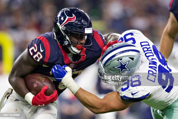 Alfred Blue of the Houston Texans runs the ball and is hit by Tyrone Crawford of the Dallas Cowboys during the second half at NRG Stadium on October...
