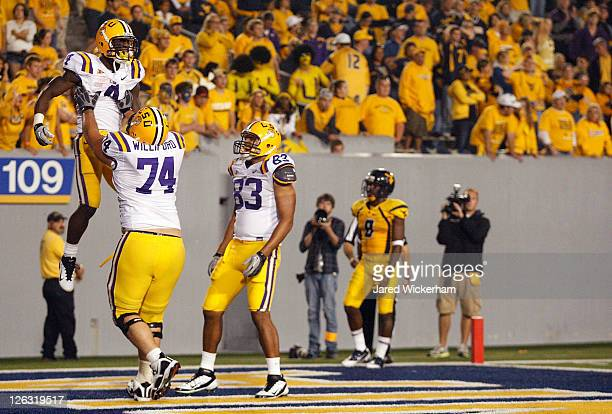 Alfred Blue of the Louisiana State University Tigers celebrates with teammate Josh Williford after scoring against the West Virginia Mountaineers...