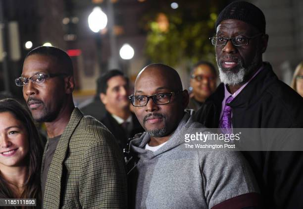 Alfred Chestnut left to right Andrew Stewart and Ransom Watkins pose for a photographer after they were released and exonerated for the 1983 murder...