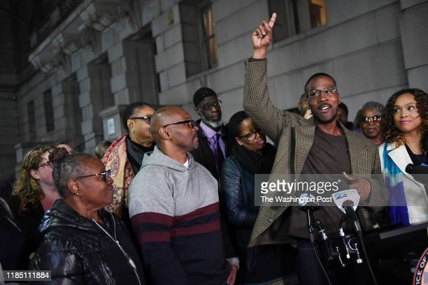 Alfred Chestnut right speaks after he Andrew Stewart left center and Ransom Watkins back center were released and exonerated for the 1983 murder they...