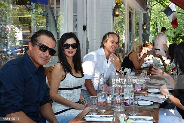 Alfred Culbreth Adriana de Moura and Frederic Marq are seen at Pierre's on August 9 2014 in Bridgehampton New York