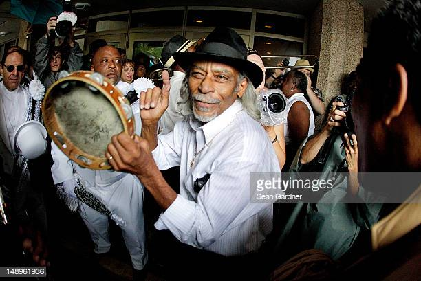 Alfred Doucette plays the tamborine during a jazz funeral held for local bass drummer Lionel Batiste July 20 2012 in New Orleans Louisiana Uncle...