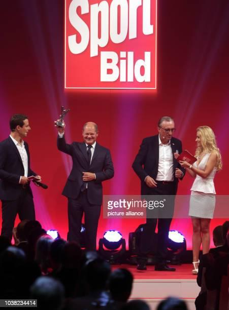 Alfred Draxler editor in chief of German sports magazine 'Sport BILD' presents Hamburg's First Mayor Olaf Scholz with the 'Olympia'Sport BILDAward...
