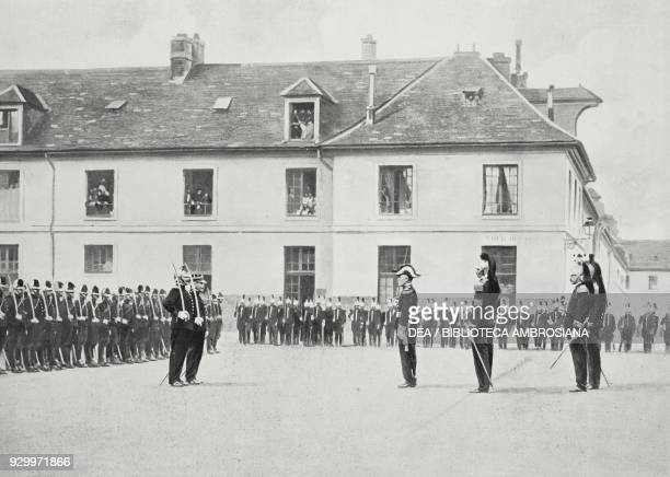 Alfred Dreyfus receiving the Legion d'Honneur from General Gillain in the courtyard of the Paris Military School, July 21 France, photograph by...