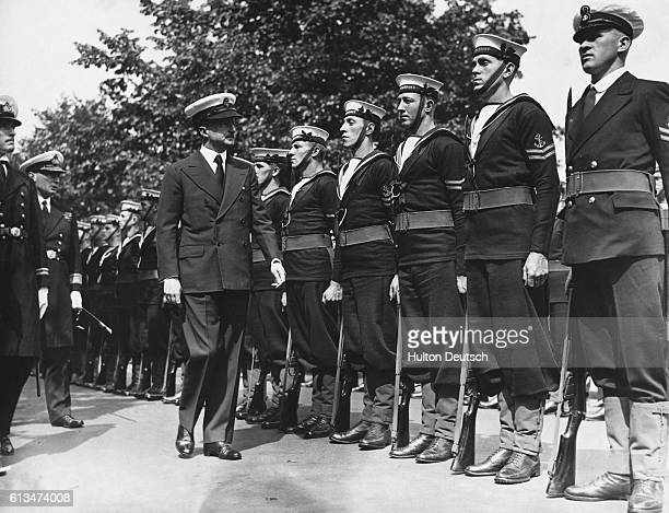 Alfred Duff Cooper, the Conservative politician and First Lord of the Admiralty, inspects a British naval guard of honour.