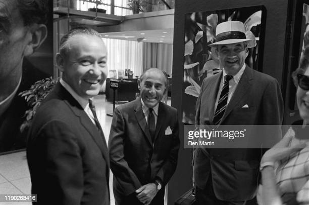 Alfred Eisenstaedt , renowned German born American staff photographer for Life magazine at his Witness to our time exhibit with colleagues, August...