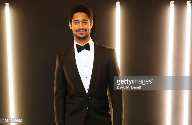 Alfred Enoch attends the dunhill PreBAFTA dinner at dunhill Bourdon House on February 6 2019 in London England
