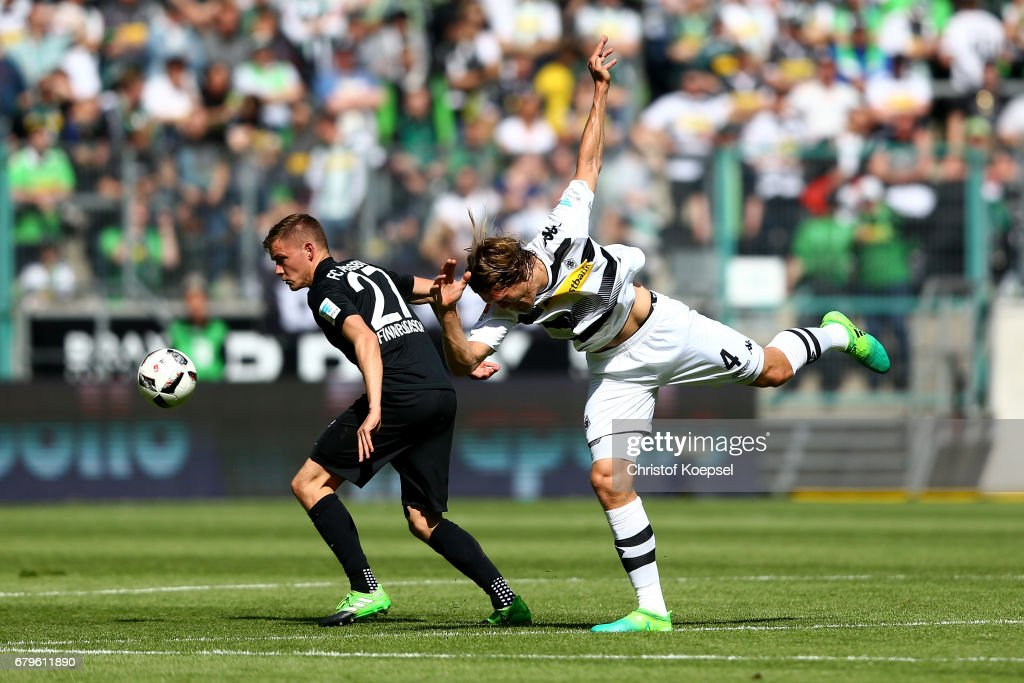 Alfred Finnbogason of Augsburg and Jannik Vestergaard of Moenchengladbach go up for a header during the Bundesliga match between Borussia Moenchengladbach and FC Augsburg at Borussia-Park on May 6, 2017 in Moenchengladbach, Germany.