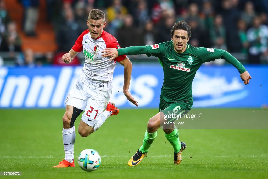 Alfred Finnbogason of Augsburg (L) and Thomas Delaney of Bremen battle for the ball during the Bundesliga match between SV Werder Bremen and FC Augsburg at Weserstadion on October 29, 2017 in Bremen, Germany.