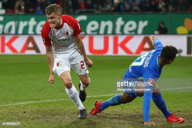 Alfred Finnbogason of Augsburg celebrates after he scored to make it 21 during the Bundesliga match between FC Augsburg and VfL Wolfsburg at WWKArena...