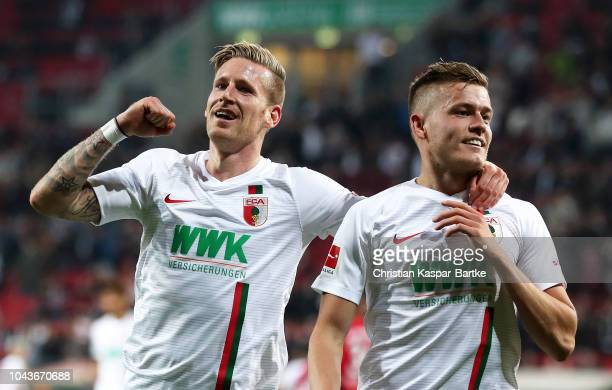 Alfred Finnbogason of Augsburg celebrates after scoring his team's fourth goal with Andre Hahn of Augsburg during the Bundesliga match between FC...