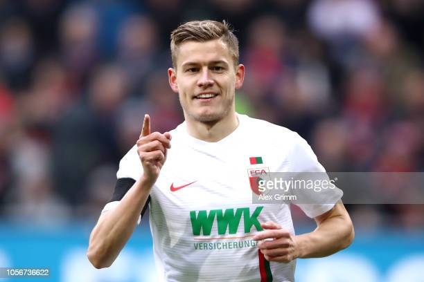 Alfred Finnbogason of Augsburg celebrates after scoring his team's first goal during the Bundesliga match between FC Augsburg and 1 FC Nuernberg at...