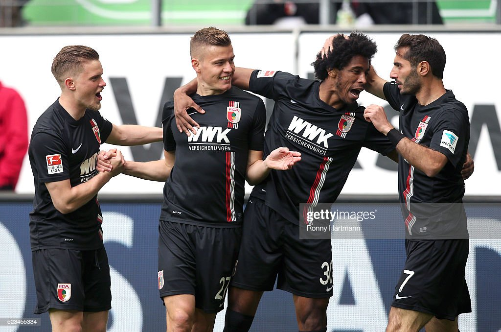 Alfred Finnbogason (2nd L) of Augsburg celebrates after scoring his team's opening goal with Philipp Max (L), Caiuby (3rd L) and Halil Altintop (R) of Augsburg during the Bundesliga match between VfL Wolfsburg and FC Augsburg at Volkswagen Arena on April 23, 2016 in Wolfsburg, Germany.