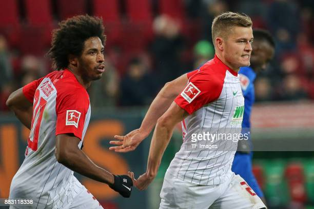 Alfred Finnbogason of Augsburg celebrates after scoring his team`s second goal with Francisco da Silva Caiuby of Augsburg during the Bundesliga match...