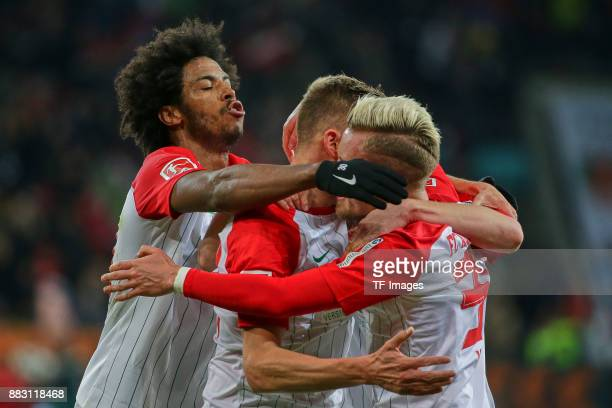 Alfred Finnbogason of Augsburg celebrates after scoring his team`s second goal with Francisco da Silva Caiuby of Augsburg and Philipp Max of Augsburg...