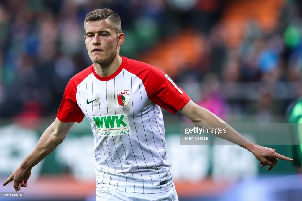 Alfred Finnbogason #27 of Augsburg celebrates after scoring penalty shot to make it 0-2 during the Bundesliga match between SV Werder Bremen and FC Augsburg at Weserstadion on October 29, 2017 in Bremen, Germany.