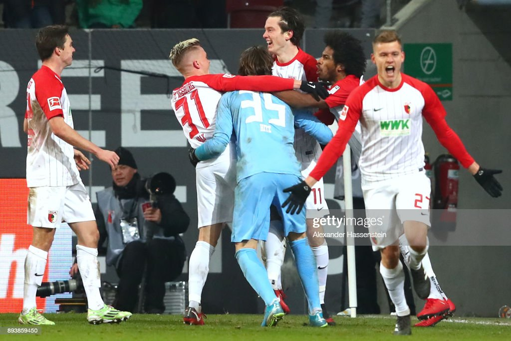 Alfred Finnbogason (R) of Augsburg celebrates scoring teh 3rd team goal during the Bundesliga match between FC Augsburg and Sport-Club Freiburg at WWK-Arena on December 16, 2017 in Augsburg, Germany.