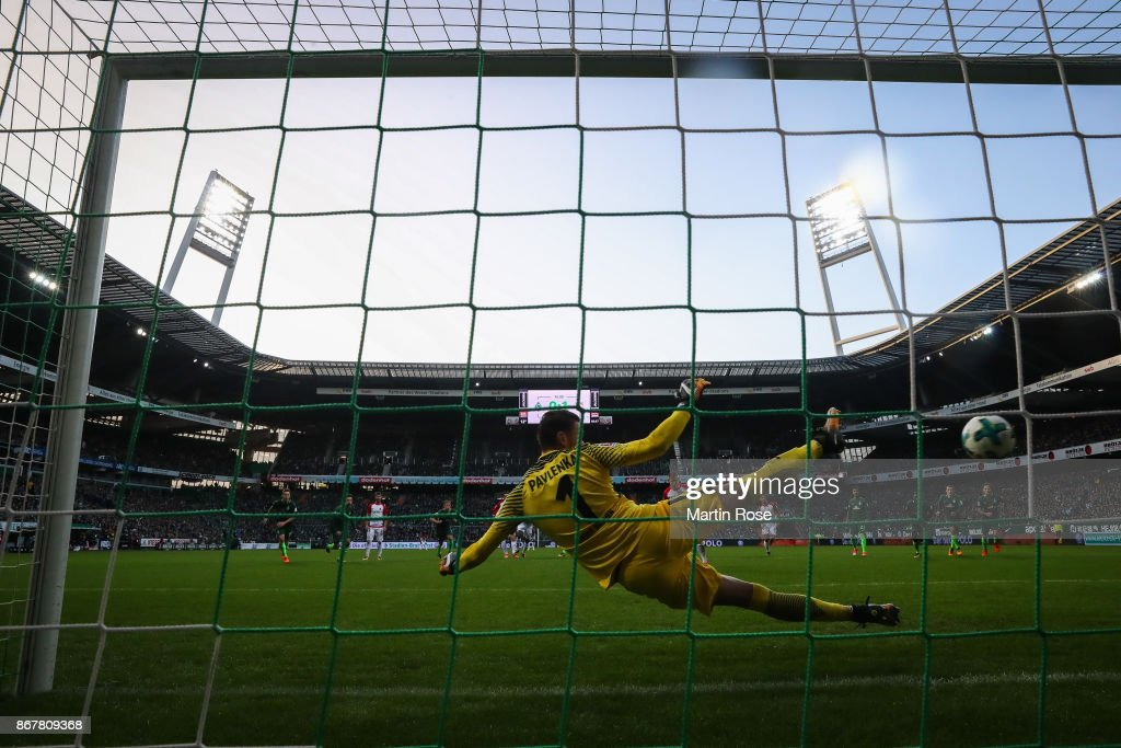 Alfred Finnbogason #27 of Augsburg scores from the penalty spot against Jiri Pavlenka goal keeper of Bremen to make it 0-2 during the Bundesliga match between SV Werder Bremen and FC Augsburg at Weserstadion on October 29, 2017 in Bremen, Germany.