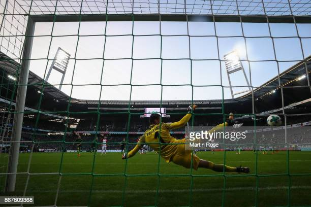 Alfred Finnbogason of Augsburg scores from the penalty spot against Jiri Pavlenka goal keeper of Bremen to make it 02 during the Bundesliga match...