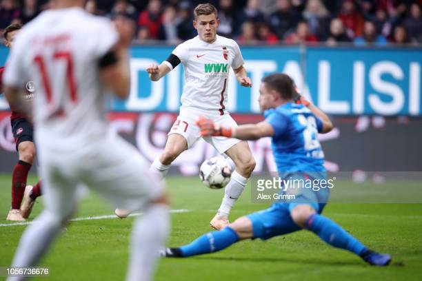 Alfred Finnbogason of Augsburg scores his sides first goal during the Bundesliga match between FC Augsburg and 1 FC Nuernberg at WWKArena on November...