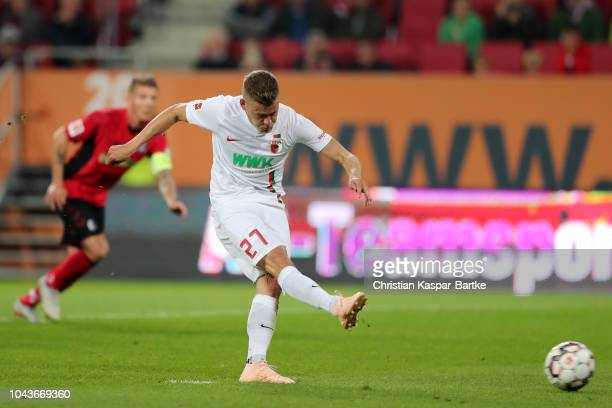Alfred Finnbogason of Augsburg scores his team's third goal from a penalty during the Bundesliga match between FC Augsburg and SportClub Freiburg at...