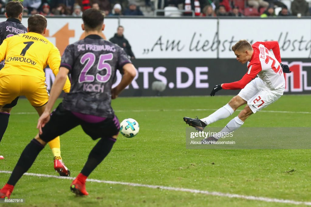 Alfred Finnbogason (R) of Augsburg scores the opening gaol during the Bundesliga match between FC Augsburg and Sport-Club Freiburg at WWK-Arena on December 16, 2017 in Augsburg, Germany.