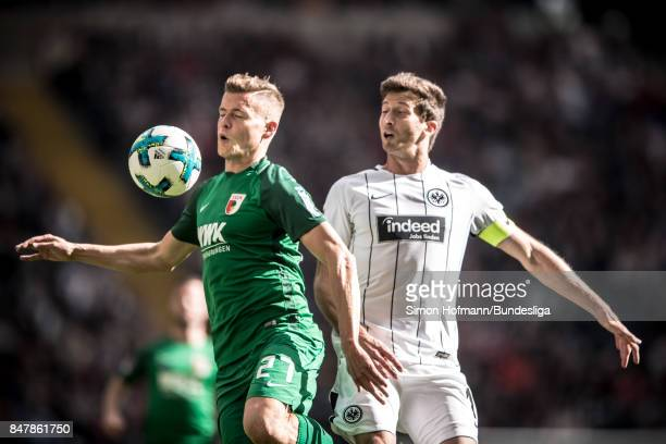 Alfred Finnbogason of Augsburg zwei David Abraham of Frankfurt during the Bundesliga match between Eintracht Frankfurt and FC Augsburg at...