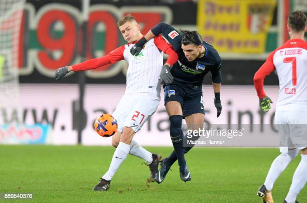 Alfred Finnbogason of FC Augsburg and Karim Rekik of Hertha BSC during the Bundesliga match between FC Augsburg and Hertha BSC on December 10 2017 in...