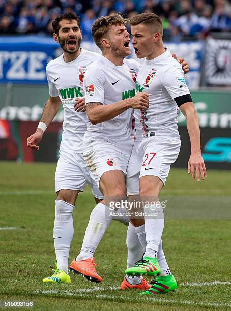 Alfred Finnbogason of FC Augsburg celebrates the second goal for his team with a penalty with Alexander Esswein of FC Augsburg and Halil Altintop of...