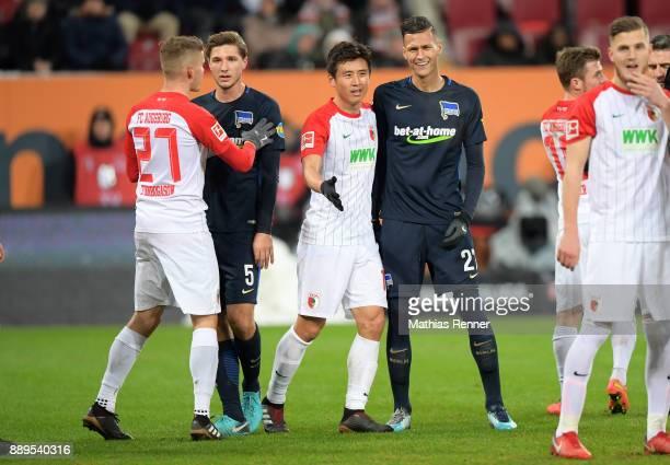 Alfred Finnbogason of FC Augsburg Niklas Stark of Hertha BSC JaCheol Koo of FC Augsburg and Davie Selke of Hertha BSC during the Bundesliga match...