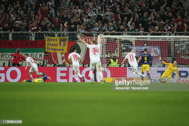 Alfred Finnbogason of FC Augsburg scores a last minute equalizing goal during the DFB Cup match between FC Augsburg and RB Leipzig at WWKArena on...