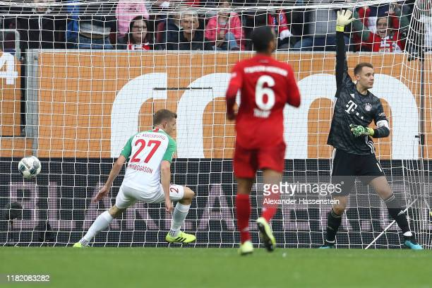 Alfred Finnbogason of FC Augsburg scores his team's second goal during the Bundesliga match between FC Augsburg and FC Bayern Muenchen at WWKArena on...