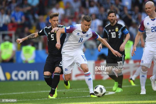 Alfred Finnbogason of Iceland and Lucas Biglia of Argentina compete for the ball during the 2018 FIFA World Cup Russia group D match between...