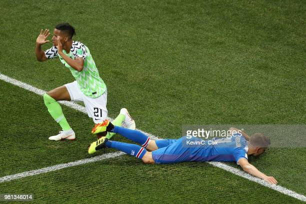 Alfred Finnbogason of Iceland reacts as he is fouled inside the penalty area as Tyronne Ebuehi of Nigeria pleads his innocence before a penalty is...
