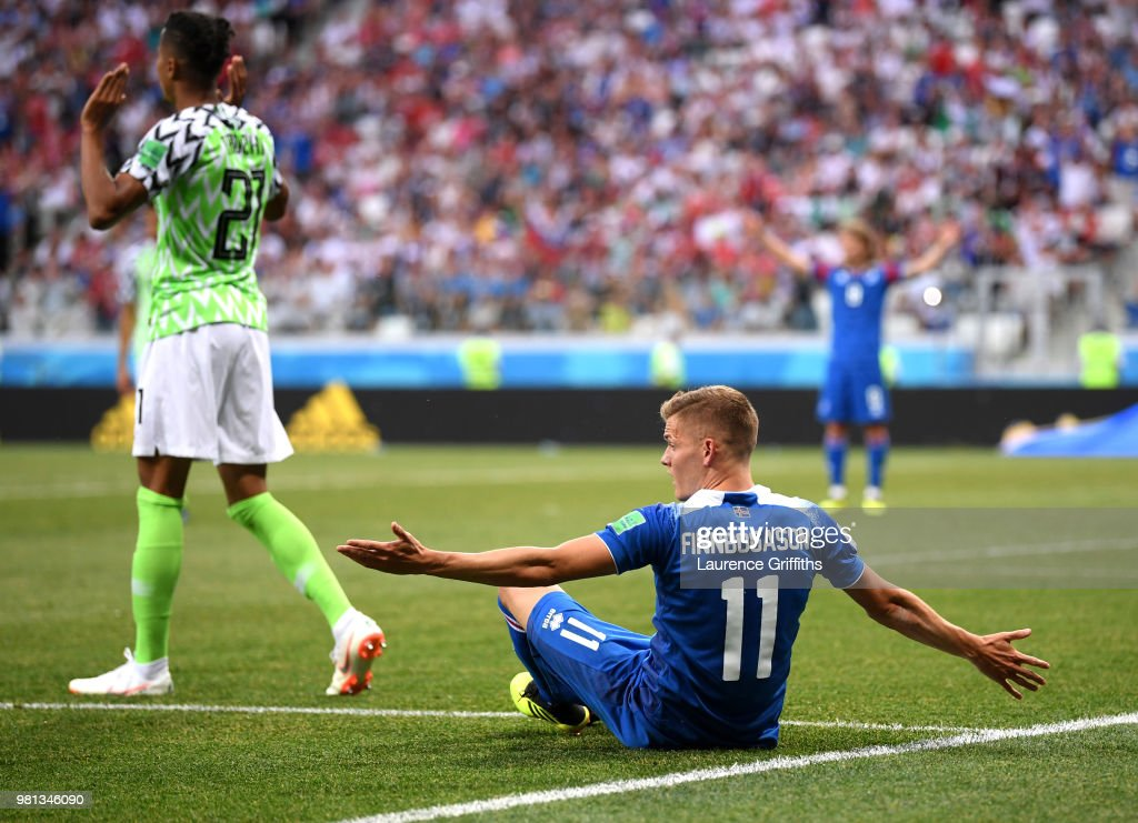 Alfred Finnbogason of Iceland reacts as he is fouled inside the penalty area as Tyronne Ebuehi of Nigeria pleads his innocence, before a penalty is then awarded after a VAR review during the 2018 FIFA World Cup Russia group D match between Nigeria and Iceland at Volgograd Arena on June 22, 2018 in Volgograd, Russia.