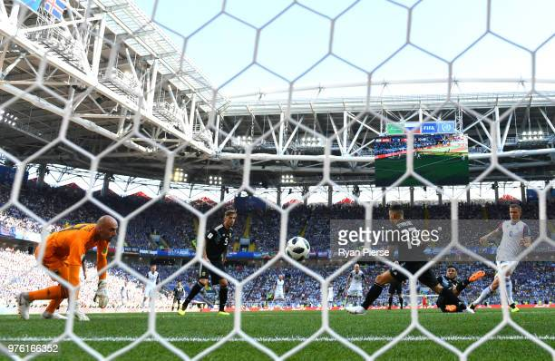 Alfred Finnbogason of Iceland scores his team's first goal past Wilfredo Caballero of Argentina during the 2018 FIFA World Cup Russia group D match...