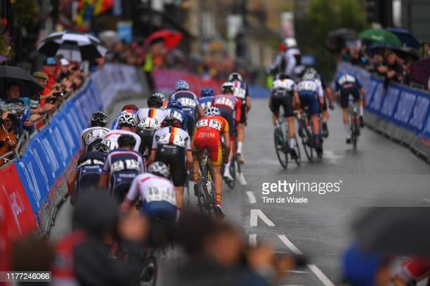 Alfred George of The United Kingdon / Patrick Eddy of Australia / Hannes Wilksch of Germany / Carlos Rodriguez Cano of Spain / Peloton / Rain / Fans...