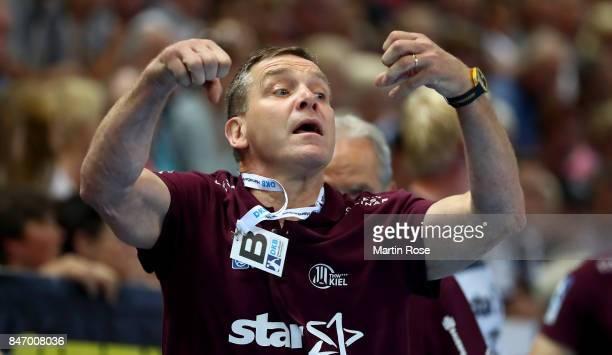Alfred Gislason head coach of Kiel reacts during the DKB HBL Bundesliga match between THW Kiel and DHfK Leiipzig at Sparkassen Arena on September 14...