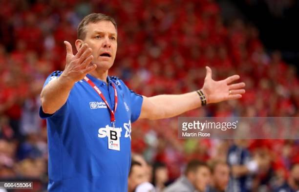 Alfred Gislason head coach of Kiel reacts during the Rewe Final Four final match between SG FlensburgHandewitt and Thw Kiel at Barclaycard Arena on...