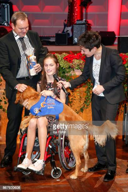 Alfred Glander Vita Team Sophia Brandner and her assistance dog Querido and German presenter Dunja Hayali during the 8th VITA Charity Gala on October...