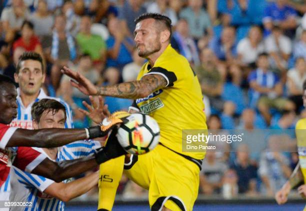 Alfred Gomis goalkeeper of Spal competes with Cyril Thereau of Udinese Calcio during the Serie A match between Spal and Udinese Calcio at Stadio...