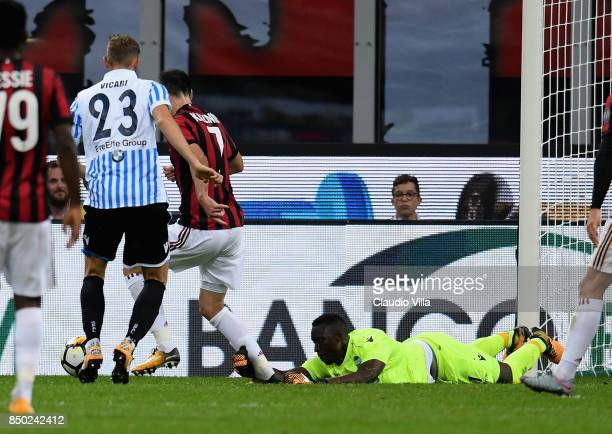 Alfred Gomis goalkeeper of Spal fouls Nikola Kalinic of AC Milan leading to a penalty during the Serie A match between AC Milan and Spal at Stadio...
