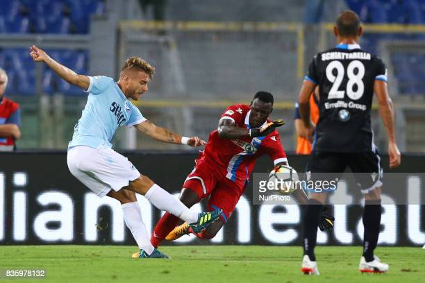 Alfred Gomis of Spal saving on Ciro Immobile of Lazio at Olimpico Stadium in Rome Italy on August 20 2017