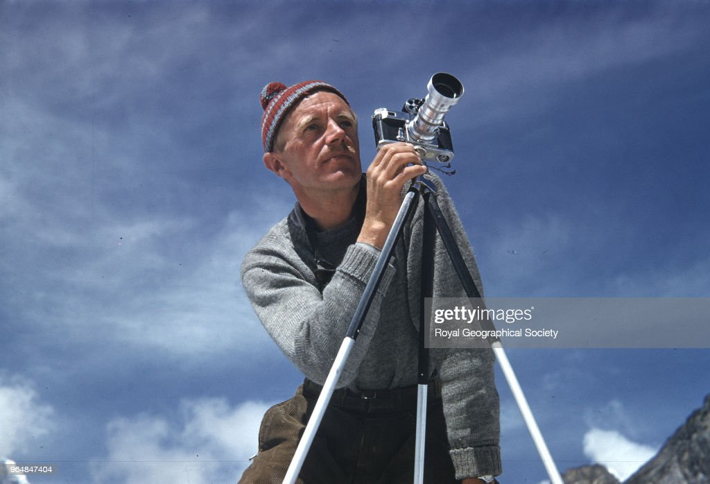 Alfred Gregory with camera on a tripod, Nepal, March 1953. Mount Everest Expedition 1953.