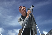Alfred gregory with camera on a tripod nepal march 1953 mount everest picture id964847404?s=170x170