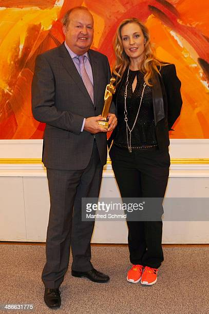 Alfred Grischgl and Lilian Klebow poses with the Romy statue at the Romy 2014 Academy Awards at Hofburg Vienna on April 24 2014 in Vienna Austria