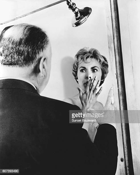"""Alfred Hitchcock and Janet Leigh on the set of """"Psycho"""", directed by Alfred Hitchcock."""