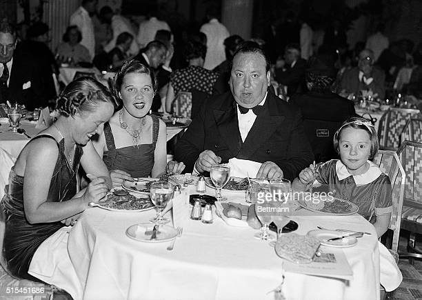 Alfred Hitchcock dining in a New York Restaurant with his wife Alma his secretary Joan Harrison and his daughter Patricia