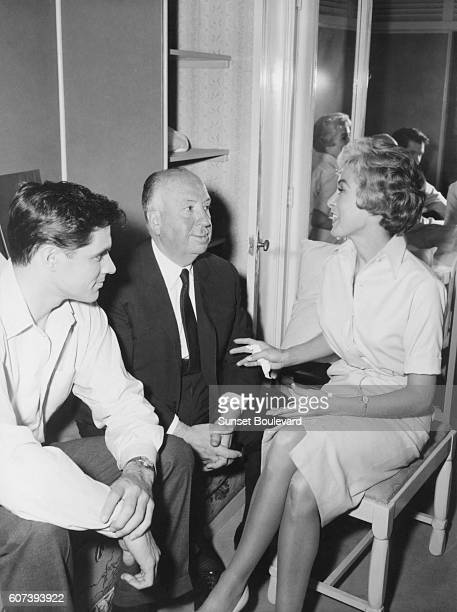 """Alfred Hitchcock, John Gavin and Janet Leigh on the set of """"Psycho"""", directed by Alfred Hitchcock."""